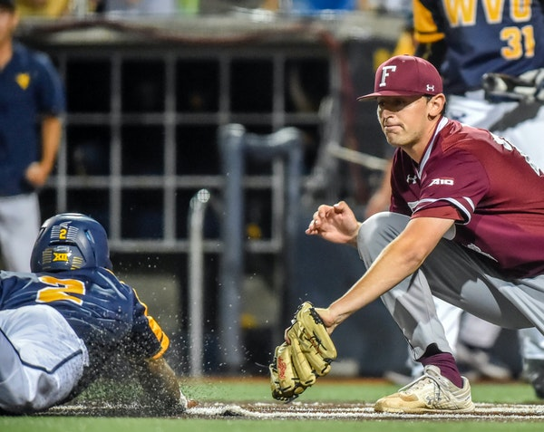 Twins signee John Stankiewicz tried to make the tag at home while pitching in a game for Fordham. He was the Atlantic 10 pitcher of the year in 2019.