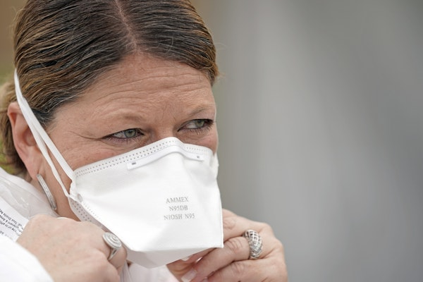 A nurse adjusted her N95 mask at a free testing site in Houston. Tight-fitting N95 masks are in such demand that hospitals are doing everything they c