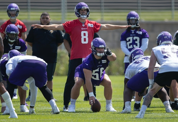 Garrett Bradbury prepared to snap the ball to quarterback Kirk Cousins during the first day of training for Vikings rookies last July.