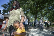 Ebony Chambers with her son Damian Kohel Jr., 4, attended a meeting at North Commons Park to discuss problems and solutions with the Minneapolis Polic