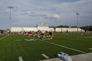 """Woodbury football players took part in the first summer workout allowed with coaches on Monday. """"It's a way different atmosphere when you're wor"""