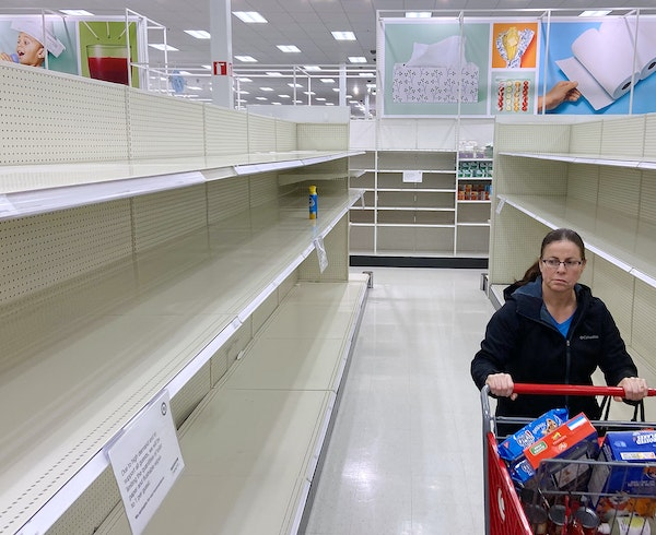 Shoppers had depleted the supply of toilet paper, disinfecting wipes and hand sanitizer in mid-March at the Target in Columbia Heights.