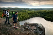 FILE-Father and son hikers, Tom and Ross Perigo enjoyed the evening view high above Bean Lake on the Superior Hiking Trail.