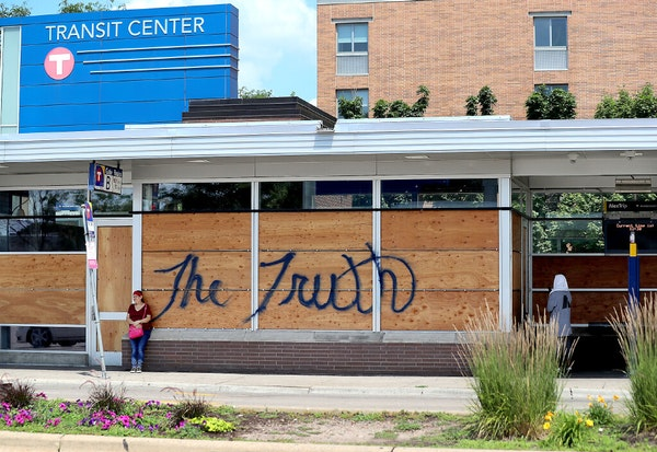 Windows were still broken out and boarded up following the killing of George Floyd and the unrest that ensued at the Transit Center on Chicago Avenue