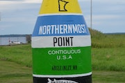 """A buoy at the lakeshore in Angle Inlet. The marker matches the design of its """"sister"""" buoy in Key West, Fla."""