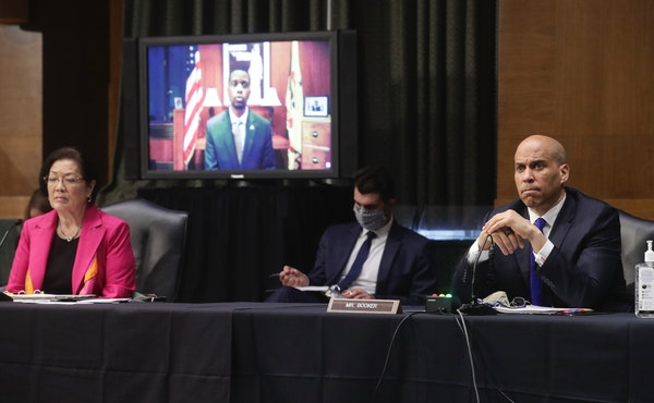Sen. Mazie Hirono, D-Hawaii, and Sen. Cory Booker, D-N.J., listened to video testimony from St. Paul Mayor Melvin Carter during a Senate Judiciary Com