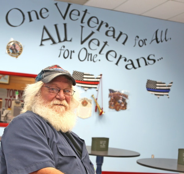 Steve Gillaspie sat in the Veteran's Mess Hall, the restaurant he plans to open in Arlington, Minn., which will help raise funds for the fishing gro