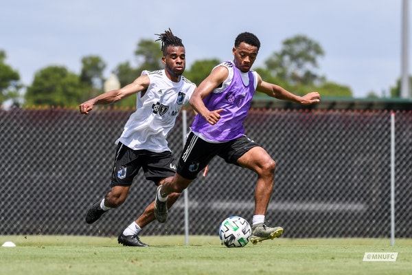 Jacori Hayes controlling the ball with Raheem Edwards defending from behind. Both are new midfielders acquired for this season. They're training at