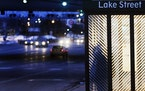 A commuter waited in a bus shelter at the Lake Street/Midtown Metro Station in Minneapolis in 2014.