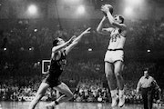 Dick Garmaker (shown in a 1955 game against Indiana), a consensus All-America basketball player for the Gophers who went on to play six seasons in the