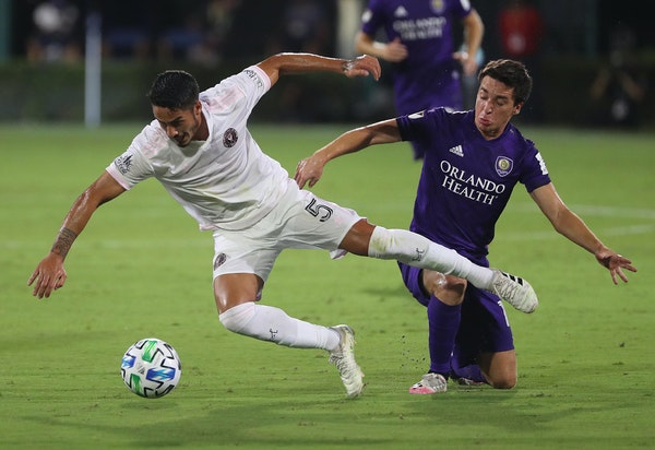 Inter Miami's Nicolas Figal (5) and Orlando City's Mauricio Pereyra battle for the ball during the MLS is Back tournament at Disney's ESPN Wide Worl