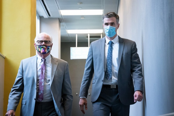 Former Minneapolis police officer Thomas Lane, right, walked out of the Hennepin County Public Safety Facility on June 29 afternoon with his attorney