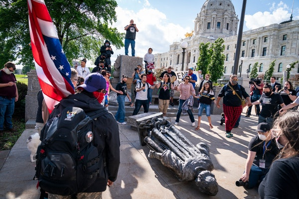 People danced in a circle around the Christopher Columbus statue after it was toppled in June on the Minnesota State Capitol grounds in St. Paul.