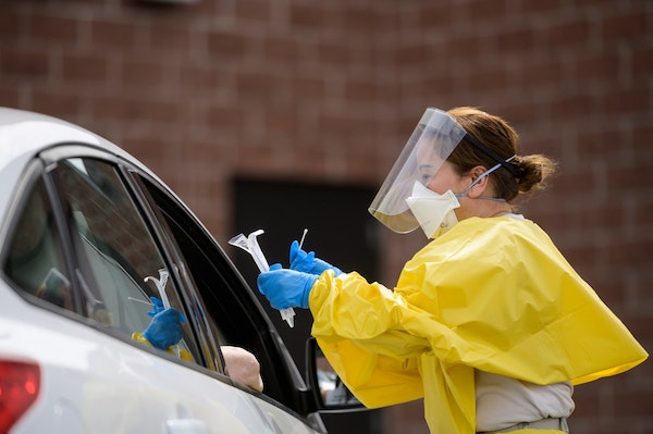 A free COVID-19 test was administered to a passenger at the drive-up testing site behind the Minneapolis Armory in May. [Credit: Aaron Lavinsky/Star T