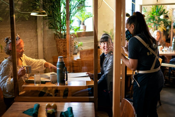 Dining in again: Anna Botz and Jessica Mealey were some of the first customers through the door as Hope Breakfast Bar opened its indoor dining room.