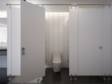 Water closet with toilet partition in public toilet.