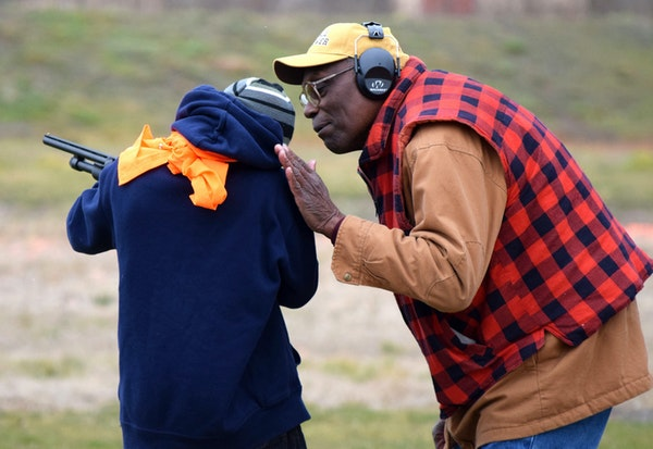 Thurman Tucker helped a young protégé at the South St. Paul Rod and Gun Club, teaching him firearms safety and how to shoot at clay targets.