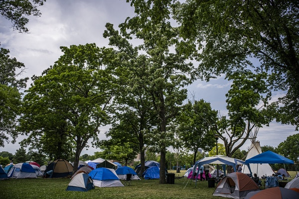 A survey found 560 tents in Powderhorn Park, but about 282 campers; people use extra tents for their belongings, a survey found.