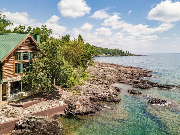 The 4,340-square-foot home features huge windows and sliding-glass doors that frame sweeping views of Lake Superior.