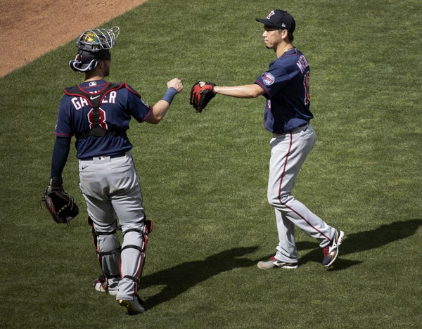 Minnesota Twins catcher Mitch Garver and pitcher Kenta Maeda during an intrasquad game at Target Field.