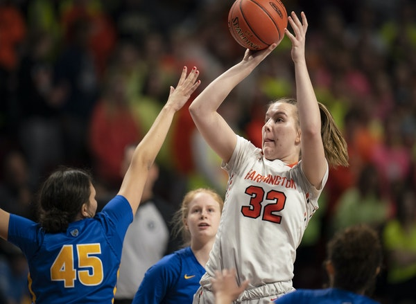 Farmington center Sophie Hart (32) put up a shot in the first half of the Tigers' Class 4A semifinal game against St. Michael-Albertville on March 1