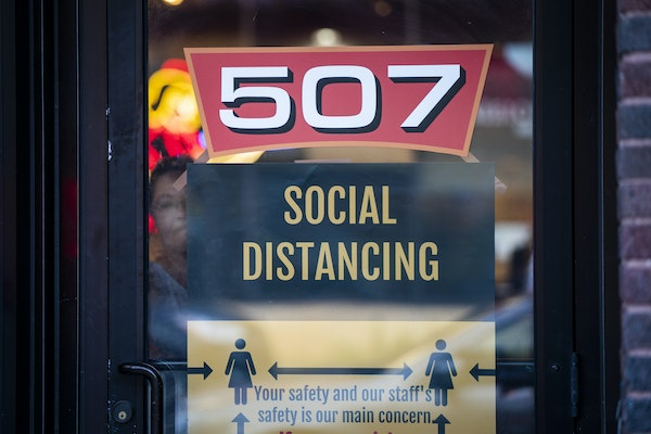 Social distancing reminders on the front door of the 507 bar in Mankato.