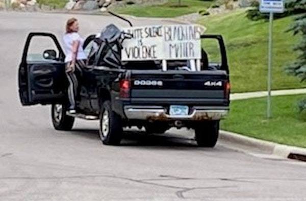 Roseville police are seeking the public's help in identifying the man and woman seen stealing yard signs in this photo. They were taken June 19.