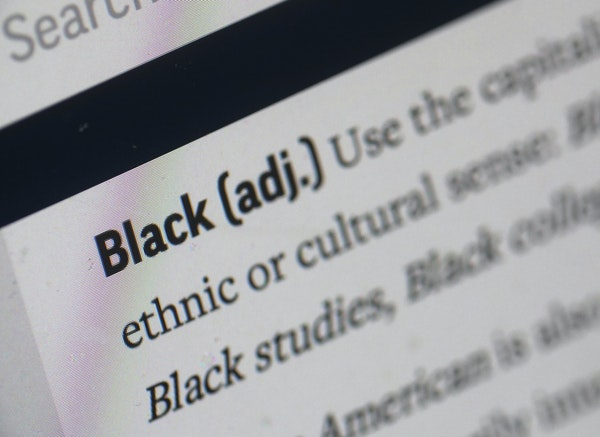 """An entry in the AP Stylebook explains the usage policy for the word """"Black."""""""