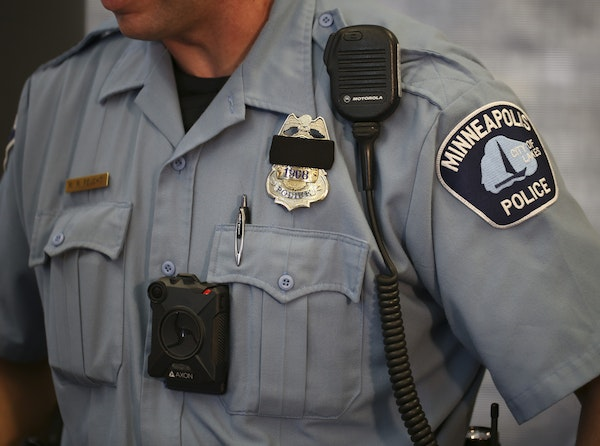 A Minneapolis police officer tested out a body camera before the department adopted them in 2017. A new policy prevents Minneapolis officers involved