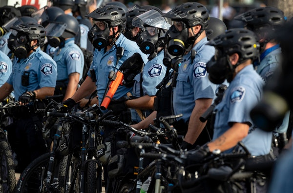 Police gathered May 27 as protests continued at the Third Precinct police station in Minneapolis after the death of George Floyd in police custody.