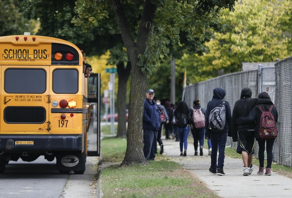 Students walked to buses and home from school at the end of the school day at South High School in Minneapolis, Minn., on Monday, October 9, 2017.