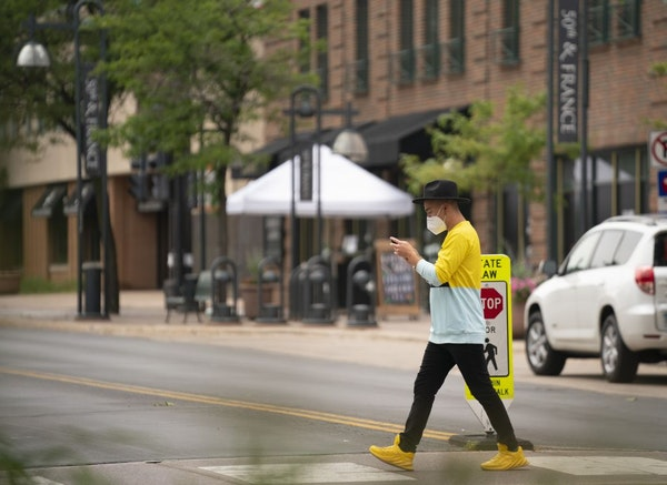 Some shoppers and diners were out at 50th and France in Edina on June 29.