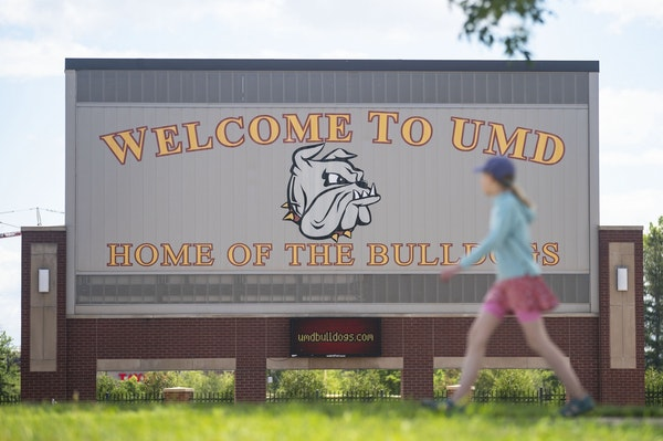 A woman walked past the University of Minnesota Duluth football stadium on Tuesday June 23, 2020.