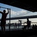 FILE -- People exercise at a public park along the East River on Manhattan's Lower East Side, June 10, 2015. A new exercise study, involving twins, sh