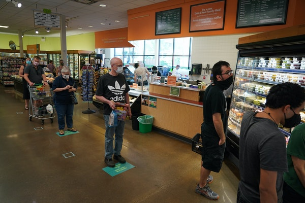 Mississippi Market in St. Paul has made changes since the COVID-19 pandemic began, including requiring masks, marking the floor with social distance g