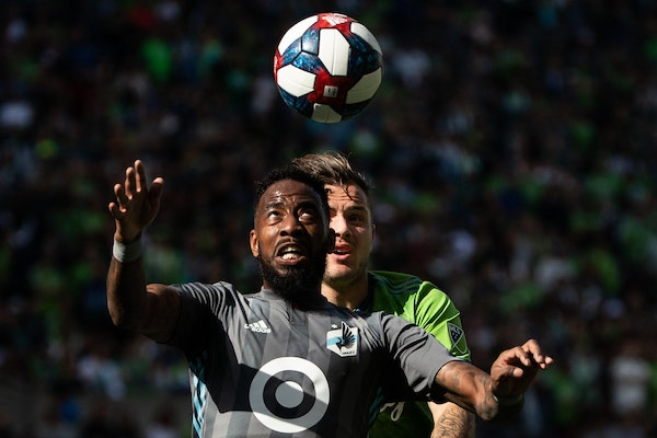 Romain Metanire of Minnesota United and Jordan Morris (13) of the Sounders competed for the ball during a game Oct. 6, 2019 in Seattle.