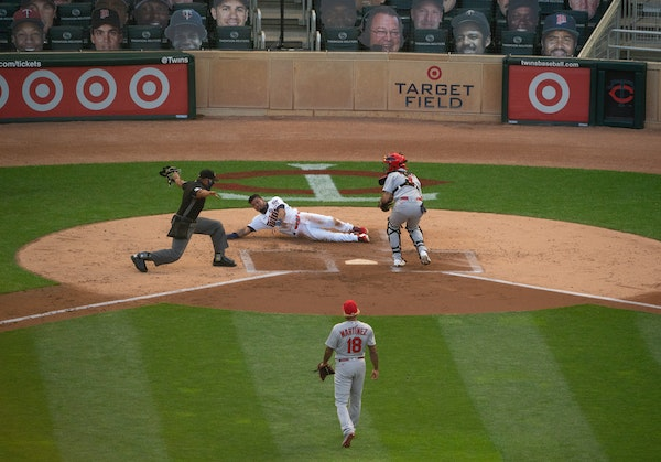 Twins second baseman Luis Arraez was safe scoring on a Byron Buxton single in the second inning.