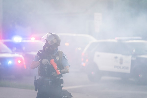 Minneapolis Police used tear gas to break up a protest outside the Fifth Precinct after the 8 p.m. curfew on May 30.