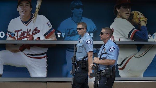 Minneapolis police officers and SWAT team members stood outside Target Field in 2019.