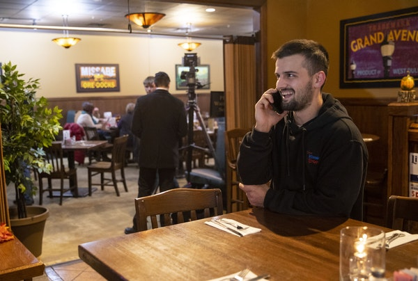 Derek Medved spoke with newly re-elected Council Member Arik Forsman on the phone at his watch party Tuesday night at G.B. Schneider. Medved won one o