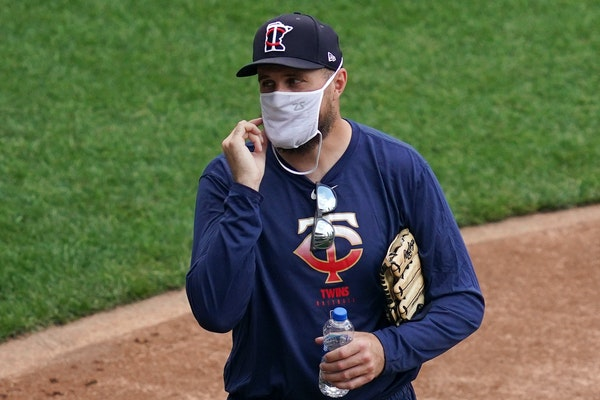 Twins manager Rocco Baldelli wore a mask during practice Friday, the team's first day back after nearly four months away because of the COVID-19 pande