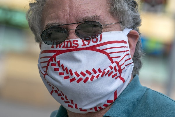Bob Brancale of Hopkins, a Twins season ticket holder since 1987, made a COVID mask out of his 1987 Homer Hanky.