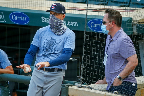 President of Baseball Operations Derek Falvey, right, recently talked with Twins manager Rocco Baldelli during training camp at Target Field.