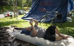 Jon, who declined to give his last name, watched a YouTube video on his phone to pass the time Wednesday afternoon in the encampment at Lyndale Farmst