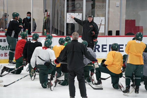 Wild Players took to the ice for practice Friday morning before leaving for Canada to re-start the season.