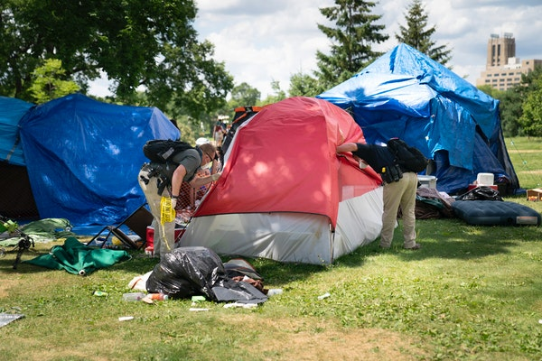 Police cleared a sprawling homeless encampment at Minneapolis' Powderhorn Park, which had swelled to several hundred people, citing increasing crime a