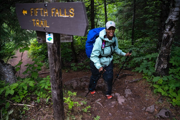 """Shown Tuesday near Gooseberry Falls, Crystal Gail Welcome made her way on a wet day. """"This is one way I can stand up for justice,"""" she said of her"""