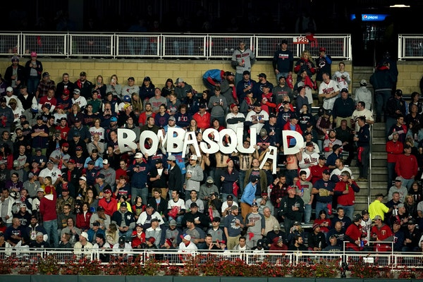 Fans held up a BombaSquad sign during last season's playoffs at Target Field.