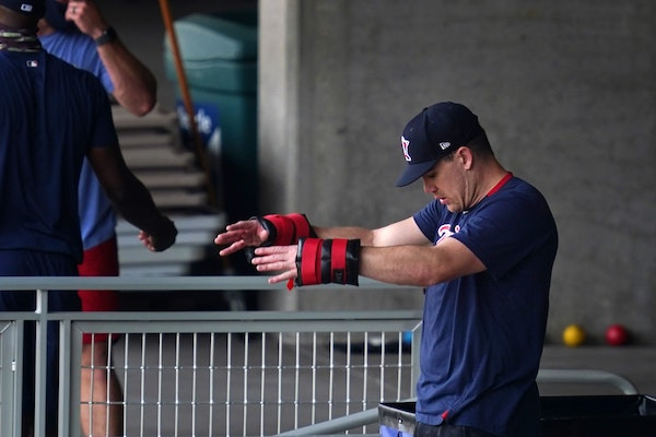 Twins pitcher Trevor May worked out with weights last week at Target Field.
