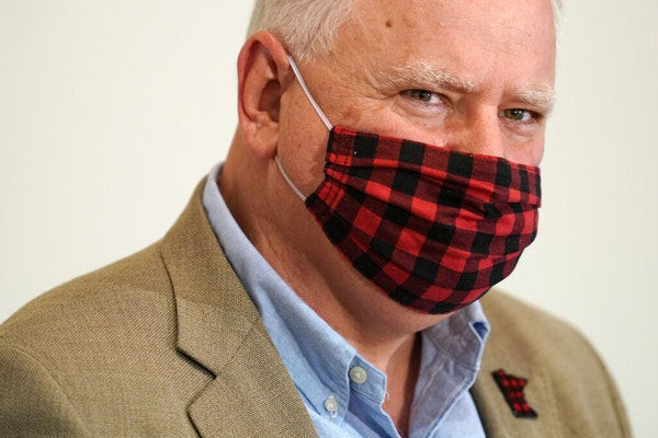 Gov. Tim Walz wore a buffalo plaid cloth mask during questions at Wednesday's news conference announcing a statewide mask mandate to help slow the spr